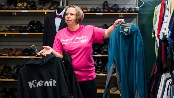 Karen Buschkill, a Hangers employee, asks a student if he likes either of the sweatshirts she is holding while they search for clothing in the boys room at Hangers, located in the Old North High School building, in Evansville, Ind., Thursday, Oct. 12, 2017. The EVSC Foundation is partnering with Hangers, a non-profit organization that provides free clothing to EVSC students from Pre-K through 12th grade, to continue the service.
