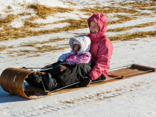 Katie Cortez and her 7-year-old daughter Mari, of Waukesha, enjoy the toboggan run at Lowell Park in Waukesha during the annual Waukesha Janboree in 2016. The Janboree, with a host of winter-themed events throughout Waukesha, returns Friday, Jan. 26.