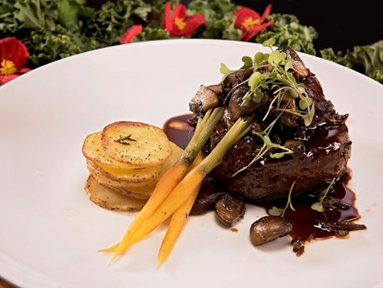 Lisa Gwatney's Wagyu ribeye filet, topped with truffle butter, sauteed mushrooms, seared foie gras and an Amarone reduction.