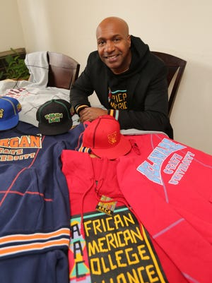 Chris Latimer from Yonkers, is the brainchild behind the re-launch of the African American College Alliance clothing brand. Here he is pictured with some of the merchandise, April 8, 2016.