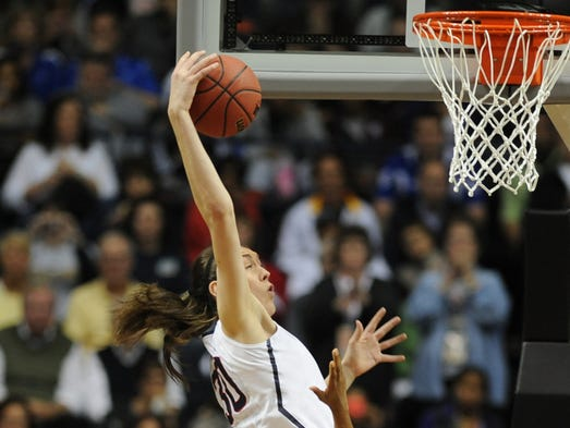 Huskie forward #30 Breanna Stewart drives to the basket during the Stanford vs. UConn game at the Women's Final Four in Bridgestone Arena, Sunday, April 6, in Nashville, Tenn.