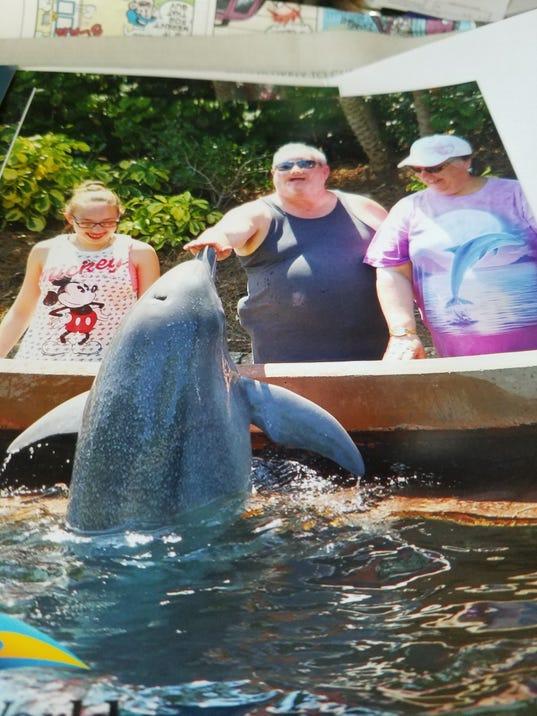 636323686715859310-Ashley-Bob-and-Mary-with-dolphin-kissing-hand.jpg