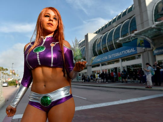 """Emily Escevarria, of San Diego, shows off her costume as Starfire from the """"Teen Titans Go!"""" television series outside Preview Night of the 2018 Comic-Con International at the San Diego Convention Center, Wednesday, July 18, 2018, in San Diego."""