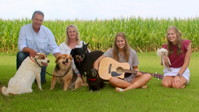 The 2020 Southeast District Farm Family is the Render Family. (l to r) Chad, Dawn, Mary-Keaton and Stella along with fur babies (l to r) Lacey, Sadie, Black Dog, Tiny, Sal and Lizzy.