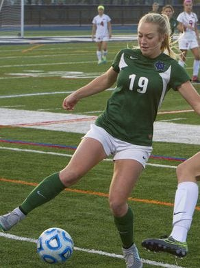 Colts Neck's Frankie Tagliaferri (19) dribbles the ball against Northern Highlands during the 2015 NJSIAA Group III girls soccer state final. Colts Neck won the game, 1-0, on Tagliaferri's penalty kick