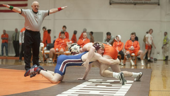 Eastern's Colton Worrell, left, and Cherokee's Nick Moffa wrestle close to the edge of the mat during the 138-pound bout of Wednesday's wrestling match held at Cherokee High School.  Moffa won, 5-1.