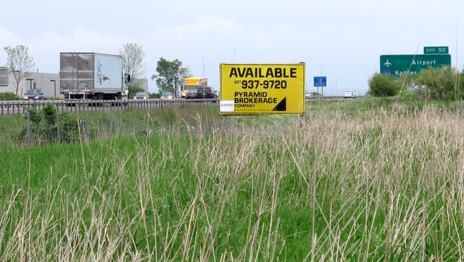 Fifteen years after Chemung County purchased a former dairy farm in Big Flats, the county is still looking for a developer to buy it.