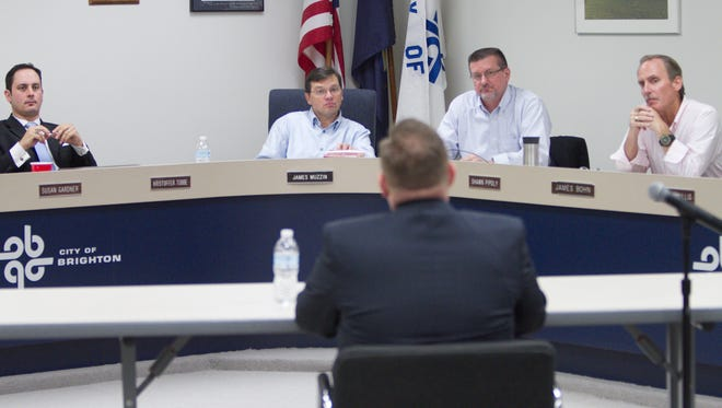 From left, Kristoffer Tobbe, Mayor Jim Muzzin, Mayor Pro Tem Shawn Pipoly and Jim Bohn listen to Brighton city manager candidate Jonathan Greene during one of a series of applicants' interviews for the job.