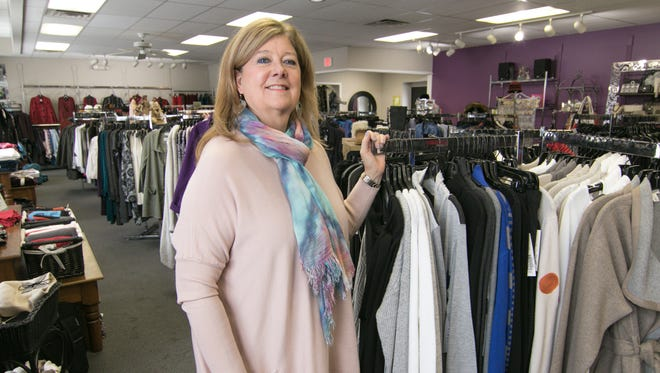 Beverly Rae's owner Debbie Carley, seen standing in her women's clothing store Friday, Dec. 15, 2017, will have to vacate 306 W. Main after settling a civil dispute with her landlord.