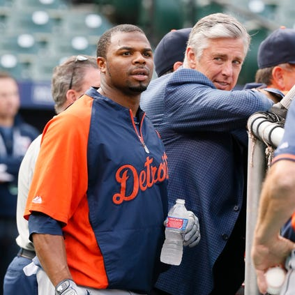 Davis and Tigers president Dave Dombrowski watch the team's practice for the ALDS.
