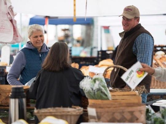 Fort Pierce Farmers' Market vendors Theresa Dormi (left),