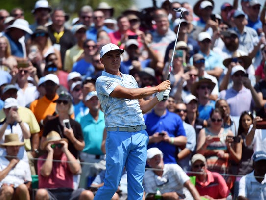 Rickie Fowler plays his shot from the third tee during