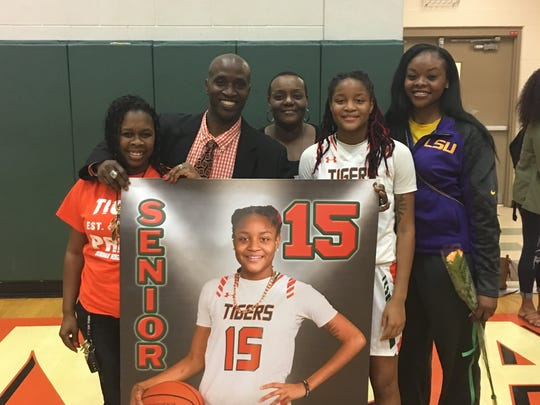 Dekeriya Patterson scored 40 points on senior night ,Jan. 24, for Dunbar in a 63-49 defeat of Cape Coral. She is pictured with, from right, LSU assistant coach Tasha Butts; Patterson's mother, Daniele Johnson; Dunbar coach Dwayne Donnell; and Donnell's wife, Shavon.