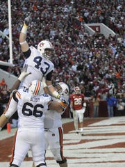 Auburn tight end Philip Lutzenkirchen (43) is lifted
