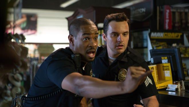 "Damon Wayans, Jr., left, and Jake Johnson star in ""Let's Be Cops."""