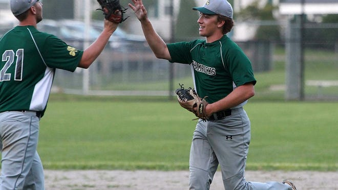 Weymouth's Kyle Sylvester is all smiles while giving a hand to Brandon Jenkins following their 5-2 win over Marshfield in Pembroke on Wednesday, July 24, 2019.