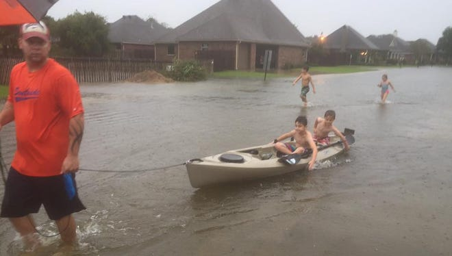 Rain flooded streets and homes in Lafayette Parish Aug. 12, 2016, that have never flooded before.
