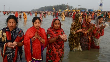 Indian Hindu devotees perform rituals after taking a holy bath in the Bay of Bengal at the mouth of the river Ganges in Sagar Island, around 150 km south of Kolkata, on January 13, 2017.