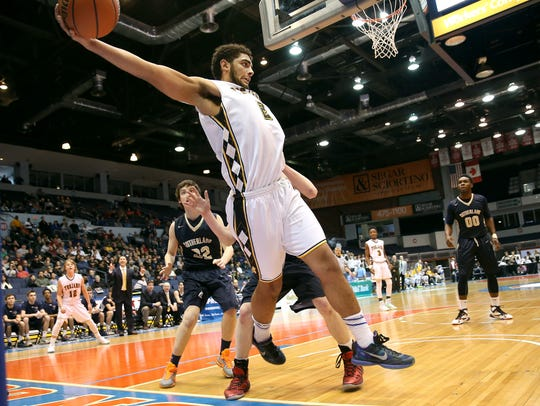 Athena's Anthony Lamb saves the ball from going out