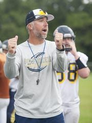Gulf Breeze head coach leads the Dolphins through a drill earlier this year. In Clayton's first year with GBHS, the Dolphins have won as many games (8) as the previous three years combined.
