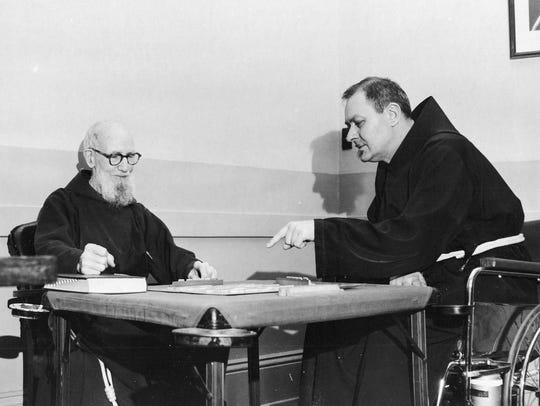 Father Solanus Casey enjoys a game of Scrabble in 1956.