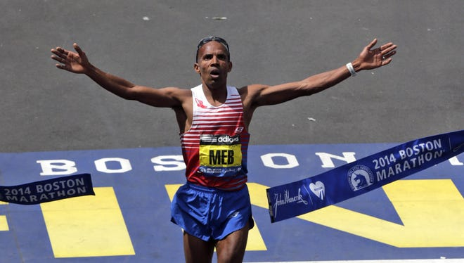 Meb Keflezighi breaks the tape Monday to win the 118th Boston Marathon.