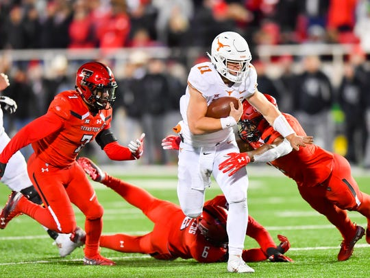 LUBBOCK, TX - NOVEMBER 10: Sam Ehlinger #11 of the Texas Longhorns runs with the ball during the 2nd half of the game against the Texas Tech Red Raiders on November 10, 2018 at Jones AT&T Stadium in Lubbock, Texas. Texas defeated Texas Tech 41-34. (Photo by John Weast/Getty Images)