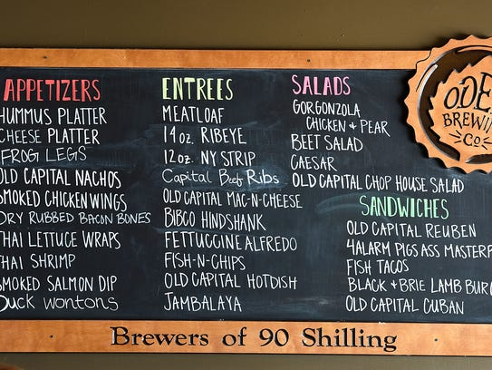 A menu board at the Old Capital Tavern, shown Wednesday,
