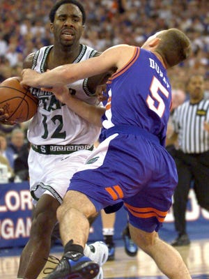 MSU's Mateen Cleaves, left, and Florida's Teddy Dupay collide early in the second half of MSU's national championship win on April 3, 2000, forcing Cleaves to leave the game with an injured ankle. Cleaves would later return, finishing the game on practically one leg.