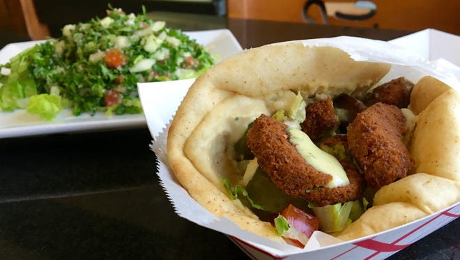 A hand-made falafel wrap with a side of tabbouleh from Opa! Mediterranean Gourmet in Fort Myers.