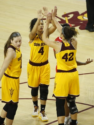 ASU's Kiara Russell (4) and Kianna Ibis (42) high-five after a basket against Arizona at Wells Fargo Arena on February 19, 2017 in Tempe, Ariz.