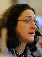 Rep. Debra J. Heffernan (D) member of the General Assembly's budget-writing Joint Finance Committee works on Gov. Jack Markell's proposed spending plan.