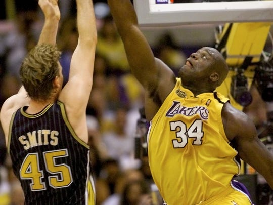 6/19/00 // NBA FINALS // GAME SIX // PACERS VS. LAKERS // MIKE FENDER PHOTO FILE #49660  Laker Shaquille O'Neal can't quite reach a Rik Smits shot in the first half.