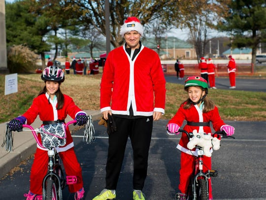 Santa run Over 500 participants took up the challenge and made a run dressed in Santa outfits as well as other Christmas inspired fashions during a fun morning sponsored by the Rotary Club of Evansville. Held at the Buffalo Trace Council, Eykamp Center, the proceeds will be used for the Rotary's Centennial Gift to the City of Evansville. Emily Yaeger was there with her family and shared her photos with Faces on their Facebook page. In this photo, we find her girls Lila and Aly getting ready for the race with their dad Luke Yaeger.