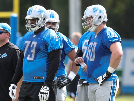 Lions tackle Greg Robinson, left, and guard Graham Glasgow watch drills during practice Sunday, July 30, 2017 in Allen Park.