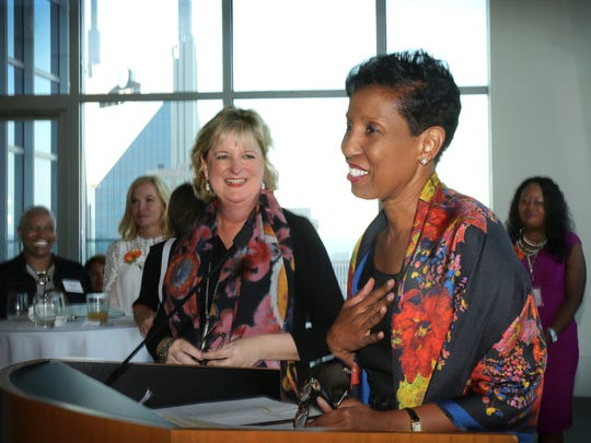 YWCA Board Chair Janet Miller looks on as Sharon Roberson