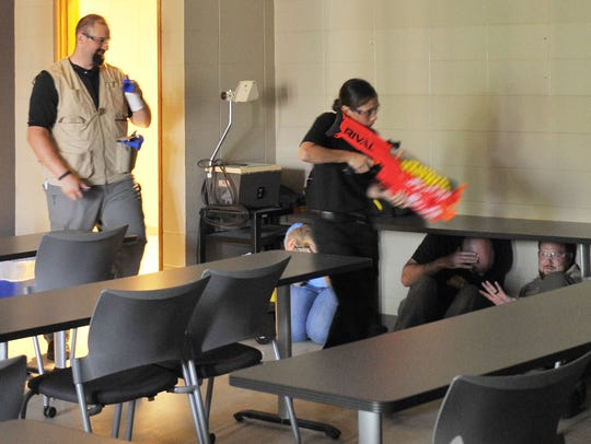 First responders practice ALICE training methods during a hands-on simulation, June 4, 2018, at the University of Sioux Falls (South Dakota) Salsbury Science Center. ALICE training encourages students and teachers to be proactive in their response to an active shooter.