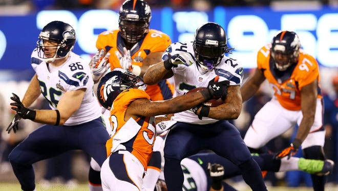 The 2014 NFL season features a Super Bowl XLVIII rematch between the Seahawks and Broncos.