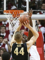 Indiana Hoosiers forward Hanner Mosquera-Perea tries to get a piece of a shot by Purdue Boilermakers center Isaac Haas in the second half. Indiana hosted Purdue at Assembly Hall on Thursday, February 19, 2015.