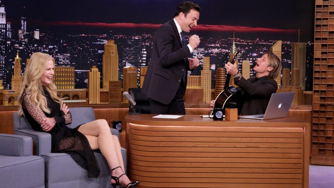 THE TONIGHT SHOW STARRING JIMMY FALLON -- Episode 0573 -- Pictured: (l-r) Actress Nicole Kidman and host Jimmy Fallon are surprised by singer Keith Urban on November 17, 2016 -- (Photo by: Andrew Lipovsky/NBC)