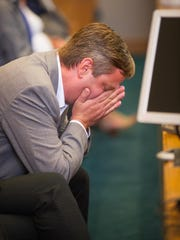 James Martin, brother of late Santa Fe County sheriff's deputy Jeremy Martin, reacts when Chief District Judge Fernando R. Macias declares a mistrial Tuesday, June 7, 2016, in Las Cruces District Court in the case of former Santa Fe County sheriff's deputy Tai Chan, accused of killing Martin in October 2014.