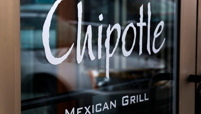 The co-CEOs of Chipotle Mexican Grill have apologized for an employee's 'hands up, don't shoot' gesture.