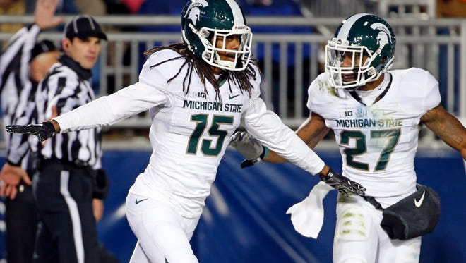 Michigan State cornerback Trae Waynes (15) celebrates with Kurtis Drummond (27) after intercepting a pass in the end zone for a touchback during the second half of an NCAA college football game in State College, Pa., Saturday, Nov. 29, 2014.