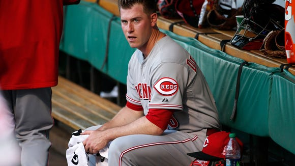 Reds starting pitcher Anthony DeSclafani sits in the dugout after warming up before Thursday's game against the Pirates.