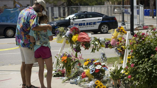 People visit a makeshift memorial near the Emanuel AME Church on June 18, 2015, in Charleston, S.C., after a mass shooting at the  church  the day before.