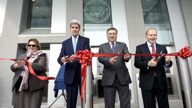 US Secretary of State John Kerry, Kyrgyzstan Foreign Minister Erlan Abdyldaev and Ambassador William H. Moser participate in a ribbon cutting ceremony at the US Embassy Saturday  in Bishkek. At a press conference, Kerry said U.S. special operations sent to Syria would only be involved in combat against the Islamic State.