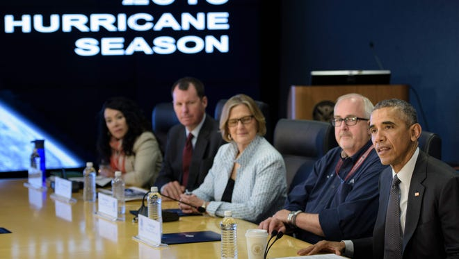 President Obama and aides at hurricane preparation briefing.
