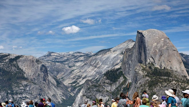 People wait near Glacier Point as US President Barack Obama and the First Family hike  celebrating the 100th year of US national park system at in Yosemite National Park,  June 18, 2016 in Yosemite Vally, California. / AFP PHOTO / Brendan SmialowskiBRENDAN SMIALOWSKI/AFP/Getty Images ORIG FILE ID: 553195835