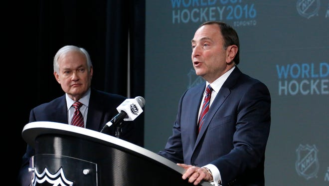 """FILE -  In this Saturday, Jan. 24, 2015 file photo, NHL Commissioner Gary Bettman, right, and NHL Player's Association Executive Director Donald Fehr take part in announcing the return of the World Cup of Hockey in 2016 in Toronto, during a news conference at Nationwide Arena in Columbus, Ohio. International Ice Hockey Federation President Rene Fasel says he had a """"good discussion,"""" with NHL Commissioner Gary Bettman and NHL Players Association Executive Director Don Fehr about the world's top hockey players participating in the 2018 Olympics, Wednesday, Nov. 16, 2016. (AP Photo/Gene J. Puskar, File)"""