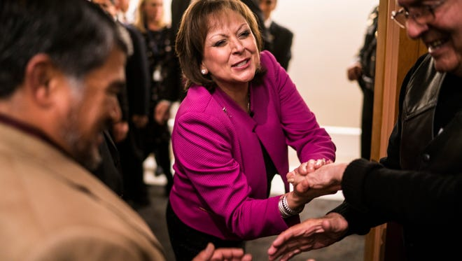 Gov. Susana Martinez is congratulated by supporters after giving the State of the State address on Tuesday  in Santa Fe.